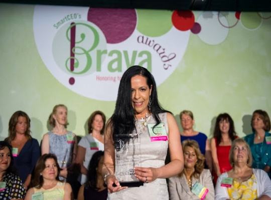 Receiving the 2013 Smart CEO Brava Award